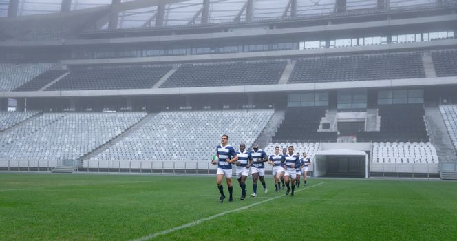 Group of male rugby players entering stadium in a row for match
