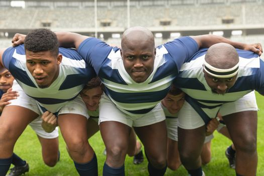 Group of diverse male rugby player ready to play rugby match in stadium