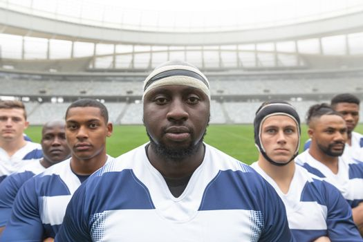 Portrait of group of diverse male rugby players standing together in stadium