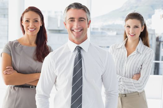 Smiling businessman with his co-workers