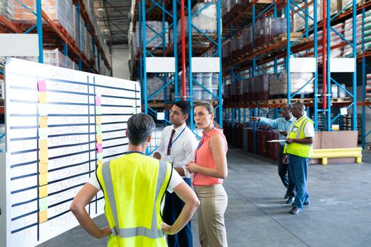 Warehouse staffs interacting with each other in warehouse