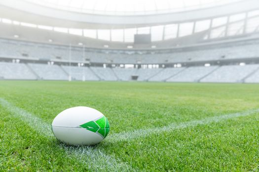 Close-up of Rugby ball on a grass in the empty stadium