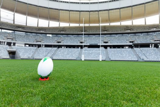 Front view rugby ball on a stand in a empty stadium