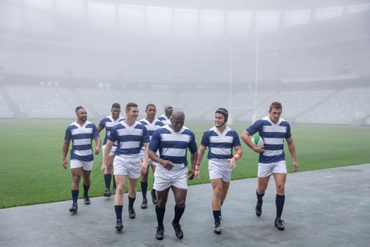 Group of male rugby player walking together after match in stadium