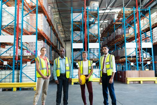Warehouse staffs standing together in warehouse