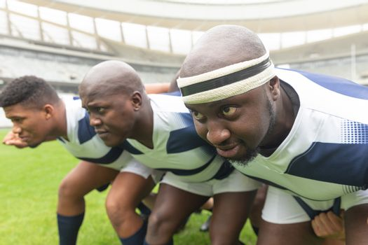 Side view of group of diverse male rugby player ready to play rugby match in stadium