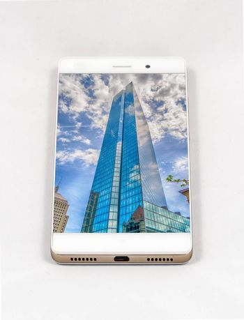 Modern smartphone with full screen picture of a skyscraper in Boston, USA. Concept for travel smartphone photography. All images in this composition made by me, separately available on my portfolio