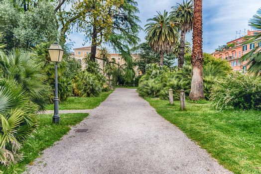 Scenic trail surrounded by nature inside a public park in the city centre of Rome, Italy