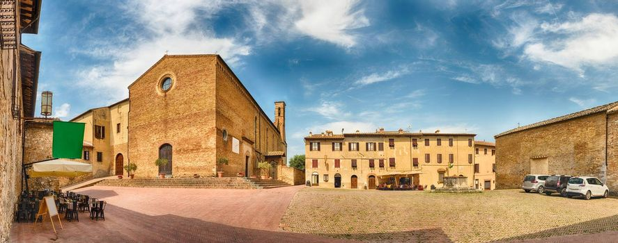 Panoramic view with the Church of Sant'Agostino, landmark in the medieval town of San Gimignano, Tuscany, Italy