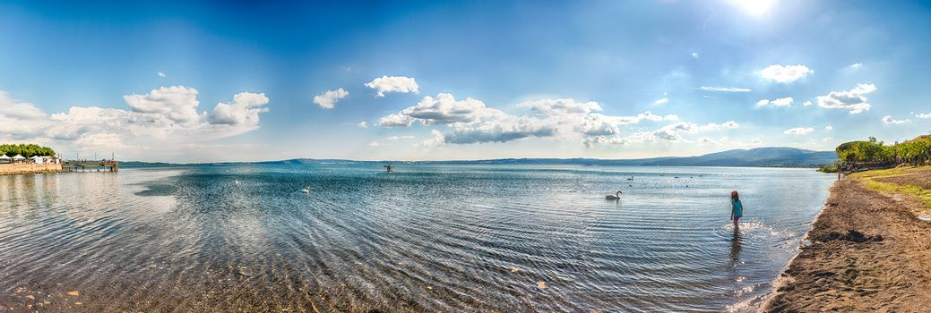 Panoramic view over lake Bracciano from the Trevignano side, with swans and a beautiful afternoon golden light