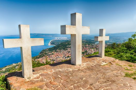 The iconic Three Crosses on the top of Mount Sant'Elia overlooking the town of Palmi on the Tyrrhenian Sea, Italy
