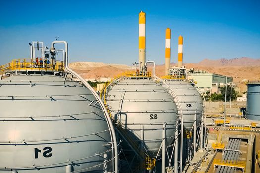 Refinery and storage facilities of oil and petroleum products. O