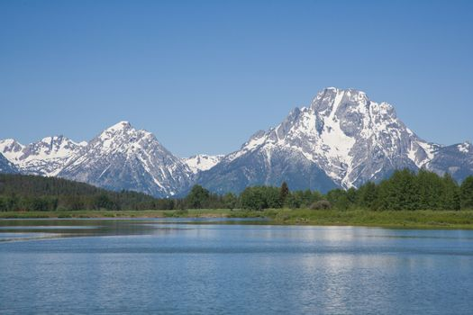 Calm blue sky day in the Grand Tetons Along the Snake River