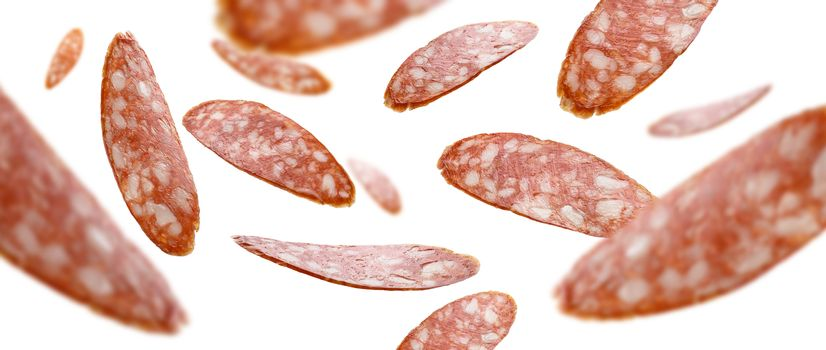 Sausage slices levitate on a white background.