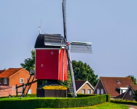 the windmill of sint annaland with the village in the background, touristic town in zeeland, The Netherlands