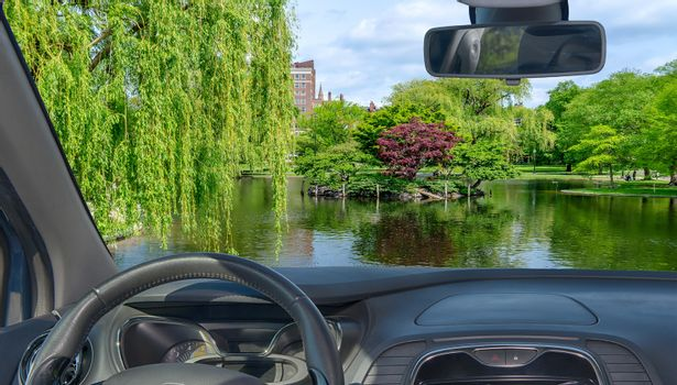 Looking through a car windshield with view of the Boston Public Garden, USA
