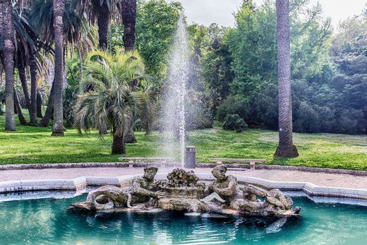 Beautiful classical fountain in Renaissance style, city centre of Rome, Italy