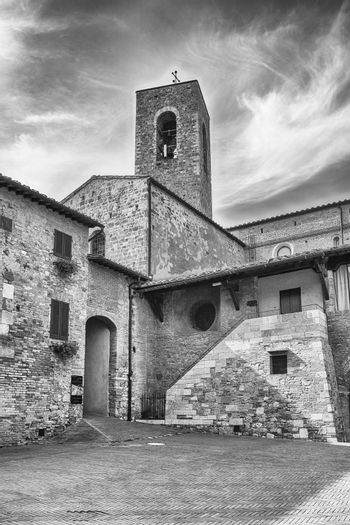 The medieval architecture of San Gimignano, iconic town in the province of Siena, and one of the most visited place in Tuscany, Italy