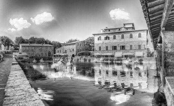 The iconic medieval thermal baths, major landmark and sightseeing in the town of Bagno Vignoni, province of Siena, Tuscany, Italy