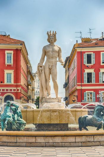 The scenic Fontaine du Soleil with the statue of Apollo in Place Massena, major landmark in Nice, Cote d'Azur, France
