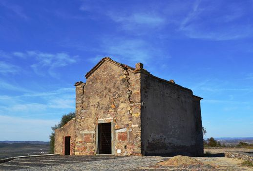 Old abandoned and ruined hermitage in the city of Monsaraz