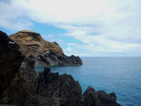 Fantastic views of the Madeira coast with the blue sea and the volcanic rock