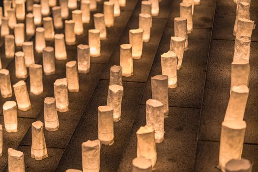 Handmade japanese washi paper lanterns illuminating the stone steps of the Zojoji temple near the Tokyo Tower during Tanabata Day on July 7th.