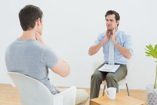 Well dressed male doctor in conversation with patient