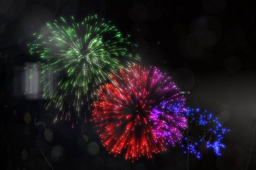 Digitally generated colourful fireworks exploding on black background