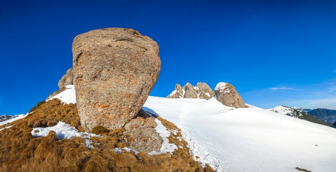 Panoramic view with rocks from Mount Ciucas peak on winter, part of Romanian Carpathian Range