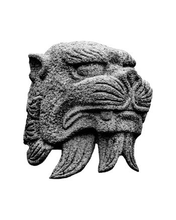 Japanese mythological feline stone head sculpture isolated on white background