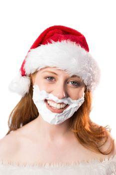 Festive redhead in foam beard