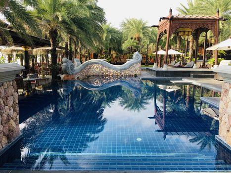 FEBRUARY 27, 2017: Ammatara Pura Pool Villa, Koh Samui, Thailand. Beautiful outdoor resort pool Swimming pool of luxury resort and spa near the sea.