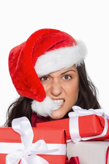 Irritated woman with christmas presents