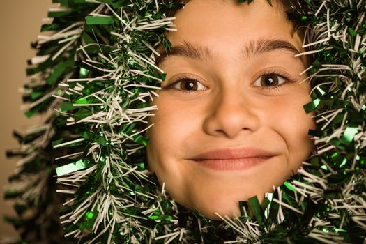 Cute little girl with tinsel around her head