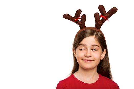 Festive little girl wearing antlers