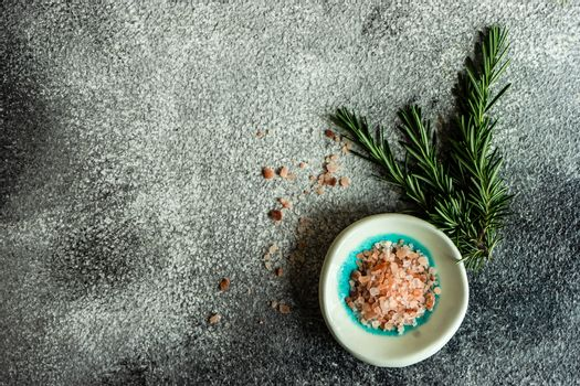 Spice cooking concept with sea salt and hot chilli pepper on dark background with copy space