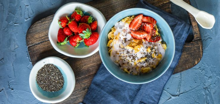 Traditional healthy breakfast with fresh organic strawberry and figs, chia seeds, yogurt and honey