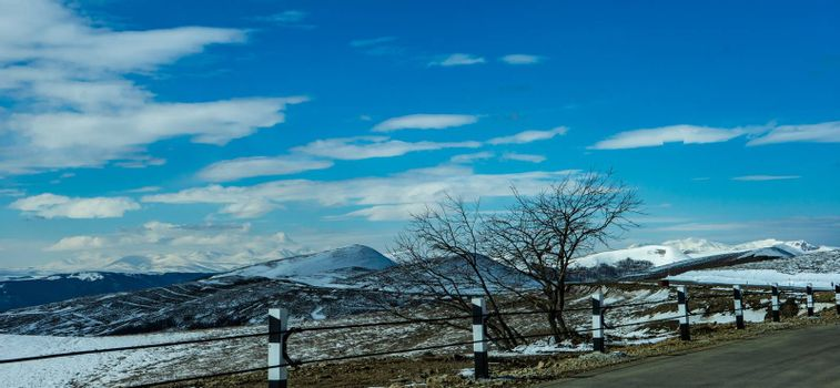 Blue winter sky and road in mountain, winter time in Caucasus mountain range close to Tbilisi, Georgia