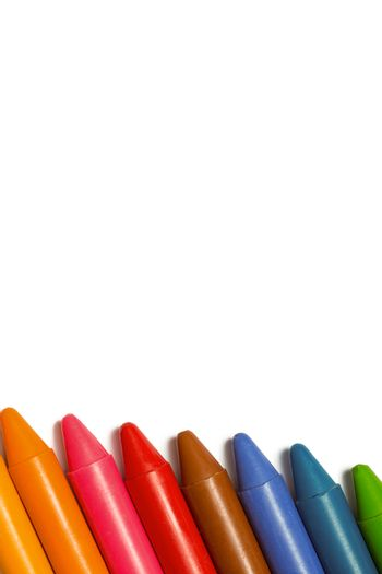 Colourful crayons in a row