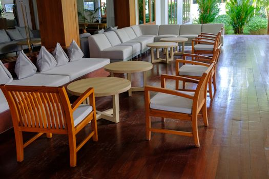 Terrace lounge with Comfortable pillow on sofa and chairs decoration. Outdoor patio in a luxury resort.