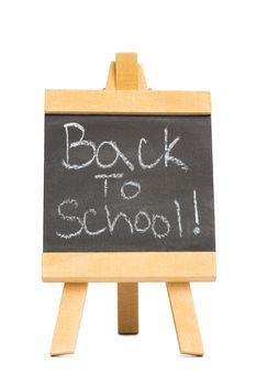 Back to school written on chalkboard on white background