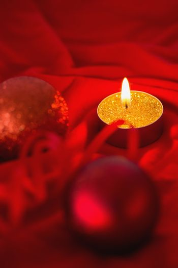 Golden tea light candle with christmas decorations