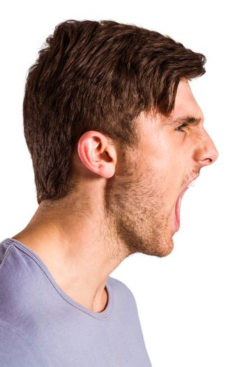 Angry young man with stubble shouting