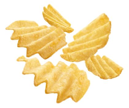 Fluted potato chips levitate on a white background.