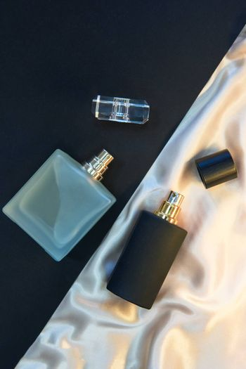 Two Perfume Bottles on paper and textile background