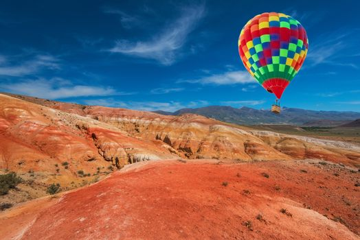 Valley of Mars landscapes in the Altai Mountains, Aerostat in the sky.
