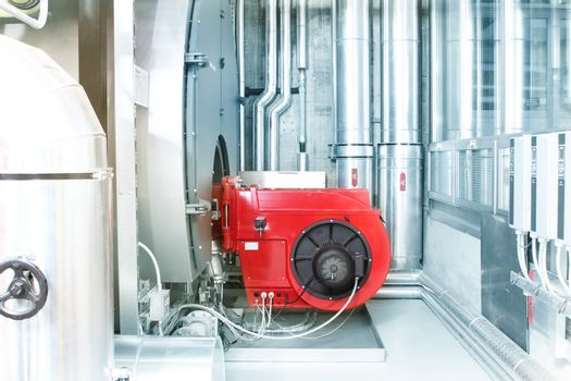 chrome pipes in heating and AC rooms in buildings of factories and hospital. Several pipes with silver pipes.