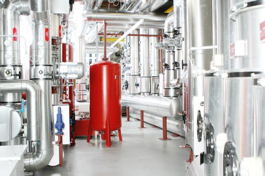 chrome pipes in heating and AC rooms in buildings of factories and hospital. Red and silver color