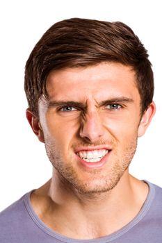 Angry young man growling at camera
